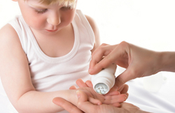 Child receiving pills