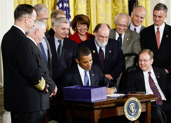 Obama signs the National Defense Appropriations Act